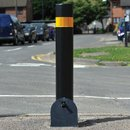 Heavy duty security bollard with reflective band